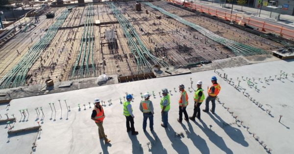 picture of construction crew waiting for last mile delivery of supplies