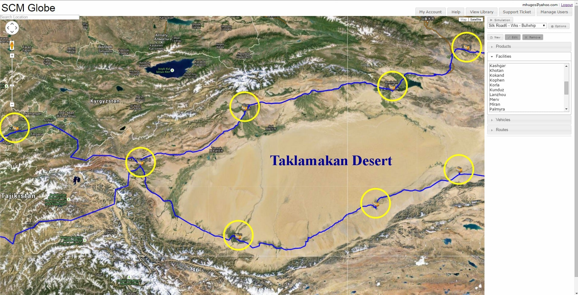 A map showing how the Silk Road splits into northern and southern routes to cross the great Taklamakan Desert. The route is highlighted in blue with yellow circles on it.